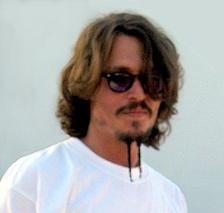 Depp wearing a mustache and goatee similar to the style used in Pirates of the Caribbean: The Curse of the Black Pearl