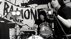 Marky on drums with Ken Stringfellow singing into a microphone