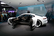 The suicide doors of the Porsche Mission E concept in open position