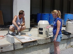 Environmental scientists preparing water autosamplers.