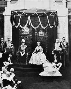King George VI, accompanied by Queen Elizabeth, grants royal assent to laws in the Canadian Senate, 19 May 1939