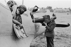 A Type F.8 Mark II (20-inch lens) aerial camera being loaded into a Supermarine Spitfire PR Mk IV at RAF Benson during the Second World War