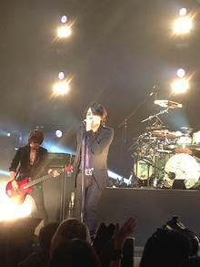 Ryuichi (center) performing with Luna Sea in Singapore 2013