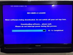 Set-top box firmware being updated