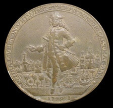 "English medal commemorating the British destruction of the forts at Cartagena. Vernon is depicted pointing at the city. The medal says ""Admiral Vernon veiwing the town of Carthagana"" [sic]. The obverse has the inscription ""The forts of Carthagena destroyd by Adm Vernon"". Naval Museum of Madrid."