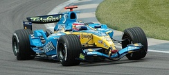 Fernando Alonso driving for Renault F1 at Indianapolis in 2005, the year in which the Renault team won the first of their two Formula One championships