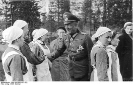 Generaloberst von Falkenhorst with the sisters of the Lotta Svärd, a Finnish voluntary auxiliary paramilitary organisation for women, in the summer of 1941 during the Continuation War