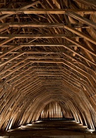 Heart of oak beams of the frame of Saint-Girons church in Monein, France