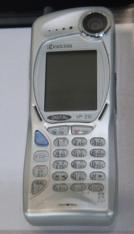 The Kyocera VP-210 Visual Phone was the first commercial mobile videophone (1999).