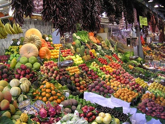 A wide variety of fruits and vegetables at the La Boqueria, a public market in the Ciutat Vella district of Barcelona, Spain
