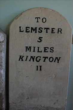 Milepost, showing the old spelling 'Lemster', now in Leominster Museum