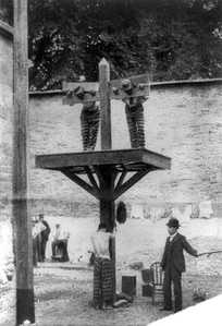 Prisoners at a whipping post in a Delaware prison, c. 1907