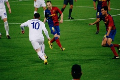 Rooney takes on Andrés Iniesta and Sergio Busquets of Barcelona during the 2009 UEFA Champions League Final.