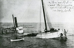 San Pedro half sunk and listing to starboard following the disaster.