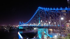 The steel cantilever Story Bridge was constructed in 1940 to connect Fortitude Valley to Kangaroo Point. In the image on the right, the bridge is illuminated in blue for ovarian cancer awareness.