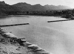 A view of the 1,100ft Bailey bridge across the Chindwin River as it nears completion, less than 12 hours after the 14th Army captured Kalewa, 2 December 1944