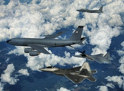 An F-22 Raptor and two F-15 Eagles from Tyndall Air Force Base participate in a refueling mission with a KC-135 Stratotanker from the Mississippi Air National Guard over eastern Florida, 22 September 2008.