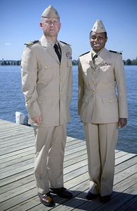 Two naval officers showcase the now-discontinued service dress khaki uniform in September 2007.