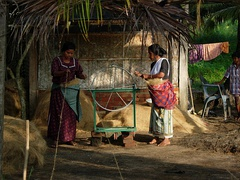 Women at work in a small scale coir spinning unit at Kollam.