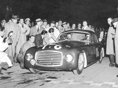 Ferrari 166 S (#003S)[15] by Allemano winning its first race, Mille Miglia (May 2, 1948) by Clemente Biondetti and Giuseppe Navone