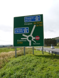 Road sign on the A702 showing the change in designation.