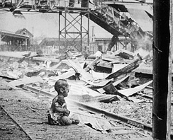 Infant crying in Shanghai's South Station after the Japanese bombing, 28 August 1937.