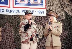 Bob Hope and Ann Jillian perform at the USO Christmas Tour during Operation Desert Shield