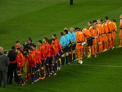 South African president Jacob Zuma and other dignitaries shaking hands with the lined-up teams before kick-off.