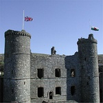 Harlech Castle with flags at half mast after the death of Queen Elizabeth the Queen Mother in 2002
