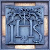 The IHS monogram with angels, in Hostýn, Czech Republic.