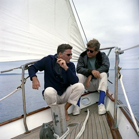 "Lawford sailing with his brother-in-law President John F. Kennedy aboard the yacht ""Manitou"", a former USCG training vessel that was used as a ""floating White House', off the coast of Johns Island, Maine, August 12, 1962"
