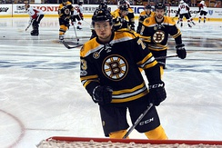 Charlie McAvoy and other players warming up prior to a game in the 2017 Stanley Cup playoffs. The Bruins qualified for the Stanley Cup playoffs for the first time since 2014.