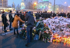 People lay flowers outside the French embassy in Moscow in memory of the victims of the November 2015 Paris attacks.