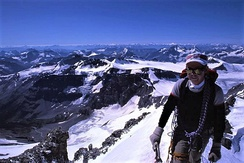 Climber on Mount Forbes' summit, the highest peak within Banff National Park (4 taller peaks on Banff's boundaries)