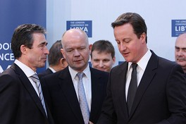 Cameron and Foreign Secretary William Hague speaking to NATO Secretary General Anders Fogh Rasmussen at the London Conference on Libya, 29 March 2011.