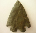 A knapped flint arrowhead.