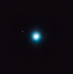 The large central object is the star CVSO 30; the small dot up and to the left is exoplanet CVSO 30c. This image was made using astrometry data from VLT's NACO and SINFONI instruments.[57]