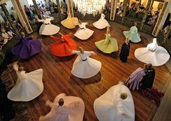 Whirling Dervishes of the Sufi Mevlevi Order, founded by the followers of the 13th-century Sufi mystic and poet Rumi in Konya, during a Sema. The ceremony is one of the 11 elements of Turkey on the UNESCO Intangible Cultural Heritage Lists.[414]