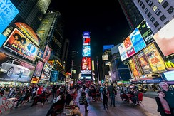 Times Square is the hub of the Broadway theater district and a media center. It also has one of the highest annual attendance rates of any tourist attraction in the world, estimated at 50 million.[54]