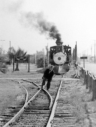 Keaton feigning getting his foot stuck in railroad tracks at Knott's Berry Farm in 1956
