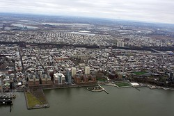 An aerial view of Hoboken from above the Hudson River