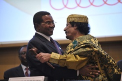 Muammar Gaddafi embracing Tanzanian President Kikwete after assuming the chairmanship.