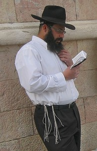 Haredi Jew wearing a kippah, a tallit, and tefillin