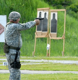 "New York Guard Staff Sgt. Joseph Dee fires an M9 pistol during the 35th Annual ""TAG (The Adjutant General) Match."