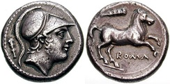 Roman silver didrachm c. 225 BC. (Obverse) head of Mars, the Roman god of war. (Reverse) horse rearing and legend ROMA. Note club on both sides, likely a reference to Hercules. Until the launch of the denarius c. 211 BC, during the Second Punic War, the Romans used Greek-style drachmae for their silver currency. They were generally minted for Rome in the Greek cities of S. Italy (esp. Neapolis)