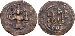 Coin of the Rashidun Caliphate with figure of Constans II standing facing, holding cross-tipped staff and globus cruciger. Pseudo-Byzantine types. Struck circa 647-670.
