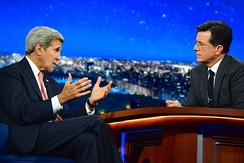 Colbert interviewing then-Secretary of State John Kerry
