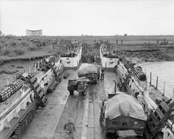 Unloading a landing craft of troops and vehicles of the 15th Indian Corps at Elephant Point, south of Yangon at the beginning of operation 'Dracula', 2 May 1945.