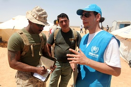 An UNHCR-officer talks with a Marine during Exercise Eager Lion 12