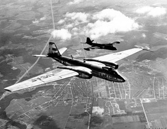 Martin RB-57D 53-3977 shown in-flight with a Tactical Air Command B-57A bomber (black plane in this formation)